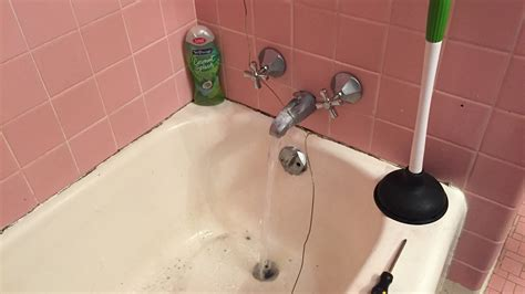 How to Unclog a Bathtub Drain with Standing Water Using a